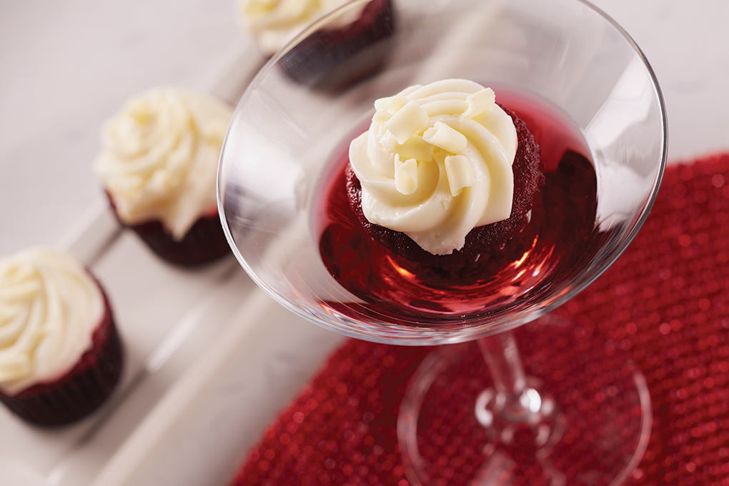 Drinks and desserts make creative companions, indeed, bringing out the best in sweets like this mini red velvet cake bite with cream cheese frosting.