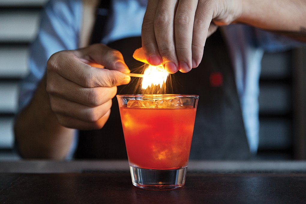 Citrusy and fire meet in this Old Fashioned with Slow & Low Rock and Rye Whiskey, Angostura bitters and flamed orange peel, on tap at Plan Check Kitchen + Bar in Los Angeles.