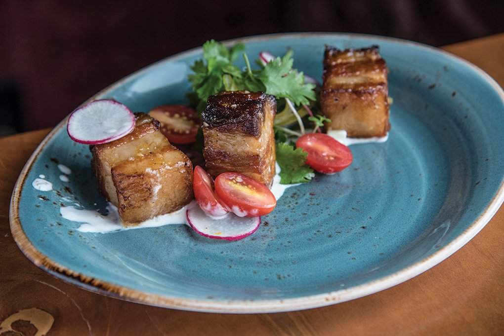 Garam Masala Pork Belly at Chauhan Ale & Masala House in Nashville consists of smaller portions of the rich meat prepared with an intensely flavored dry rub of garam masala and brown sugar.