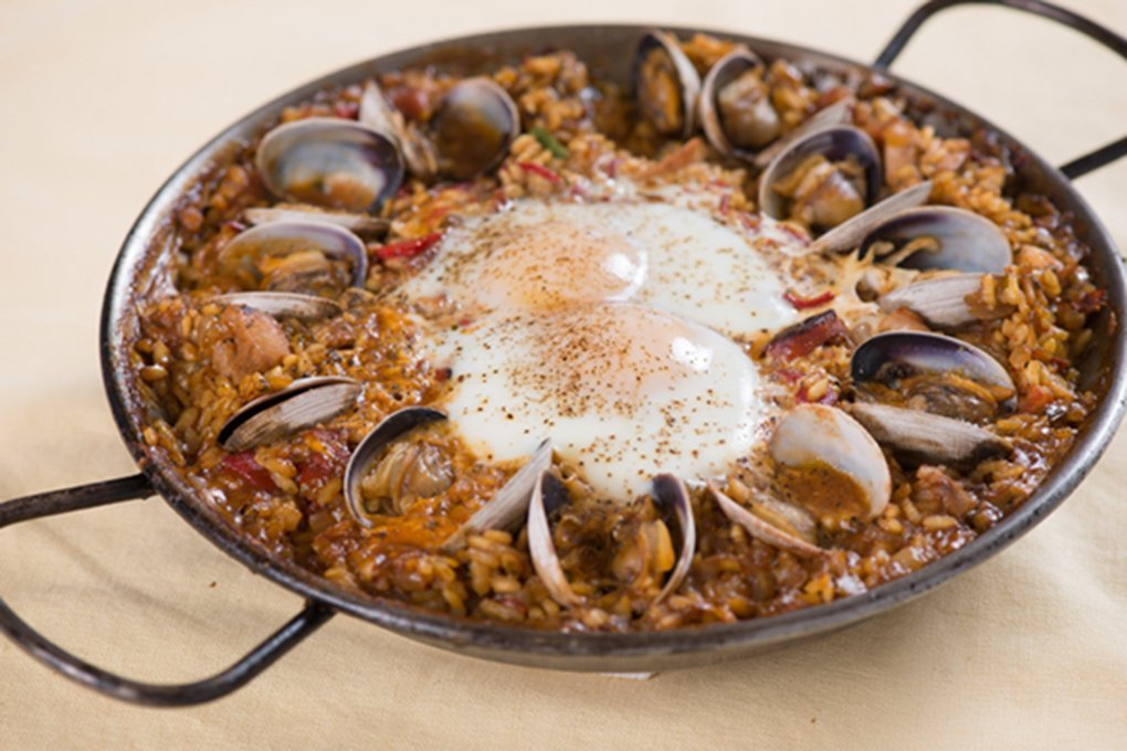 Paella With Chicken, Chorizo, Clams And Shirred Eggs