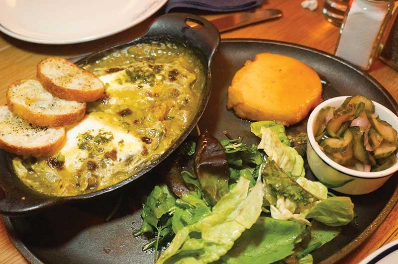 Harold's in New York offers a multitude of combinations. Here, Green Chile Tripe is served with Japanese sweet potato, cucumber salad and herbed salad.