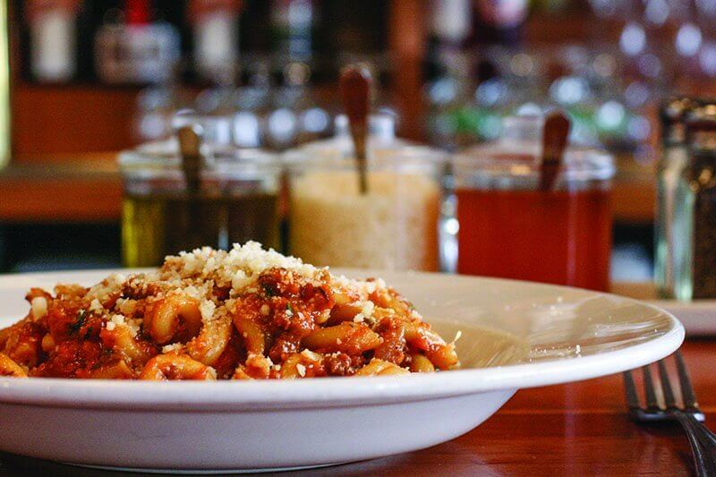 "Pastaria's Strozzapreti with ""Pastaria Bolognese"" and Grana Padano is one of the most popular dishes on the menu, thanks to how well the pasta picks up the homey, flavorful sauce."