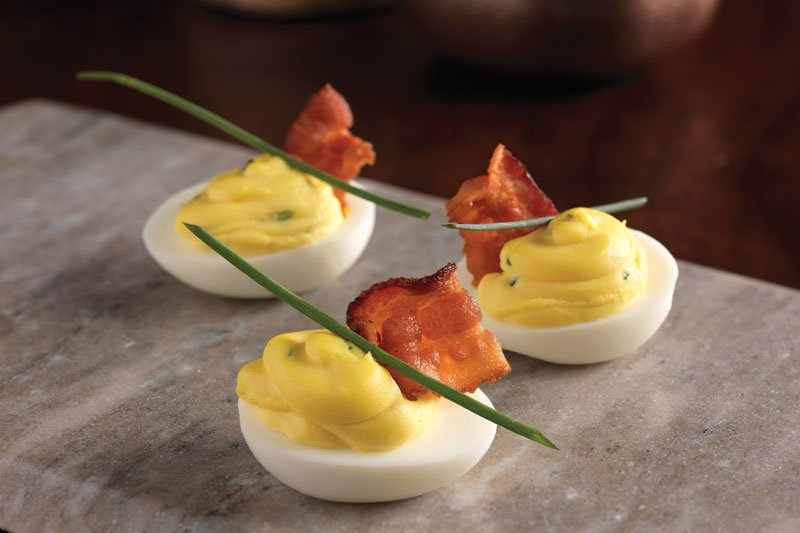 Bacon Truffle Deviled Eggs - Truffle oil brings rich, smoky tones