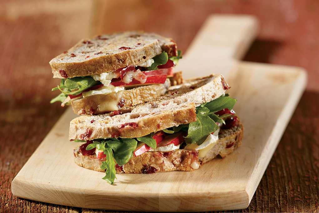 Inspired layering lifts meatless sandwiches to new flavor heights: the combination of cranberry, apple and goat cheese make this a tasty meat-free option.