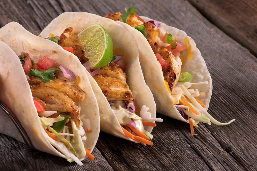 The grilled cod in Quaker Steak & Lube's fish tacos gets a flavor punch from a mango-habanero dry rub; an avocado-lime ranch dressing and pico de gallo add further depth.