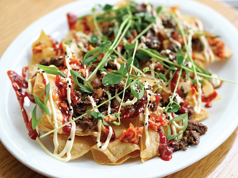 Cheese can now accompany Asian flavors with ease. Pepper Jack cheese sauce merges with bulgogi and gochujang on these Korean-Style Nachos at Graze in Madison, Wis.