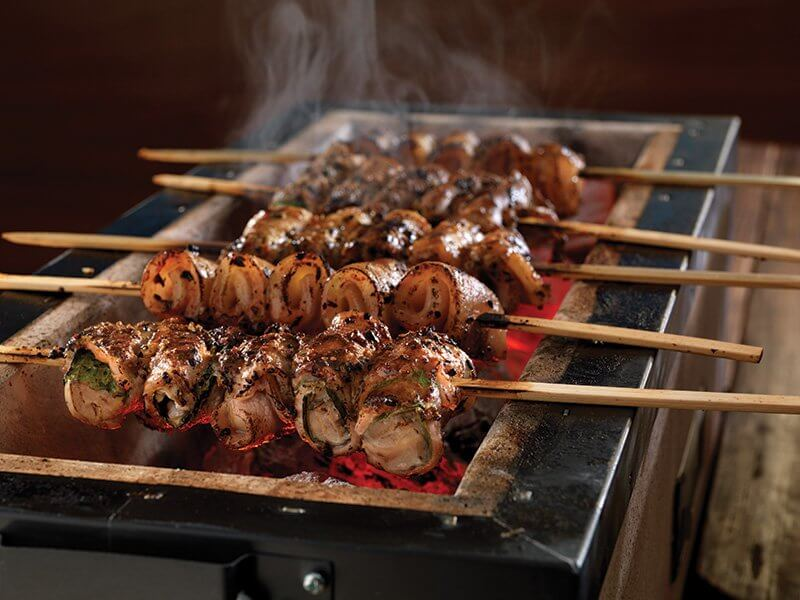 Pork kushiyaki over Japanese coals delivers the flavor of fire, along with complex, savory notes from togarashi and tare sauce (pork, sake, mirin, light soy sauce and black pepper).