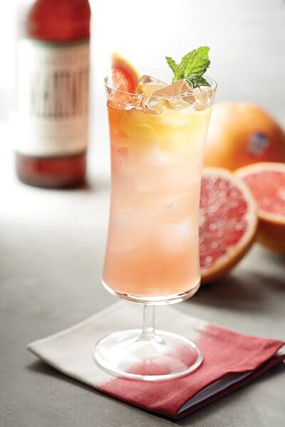 Grapefruit juice serves as a modern base for innovation, here, with a splash of simple syrup and tea for an on-trend take.