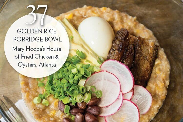 Golden Rice Porridge Bowl with pork belly, boiled peanuts, Calabrese chile and six-minute egg
