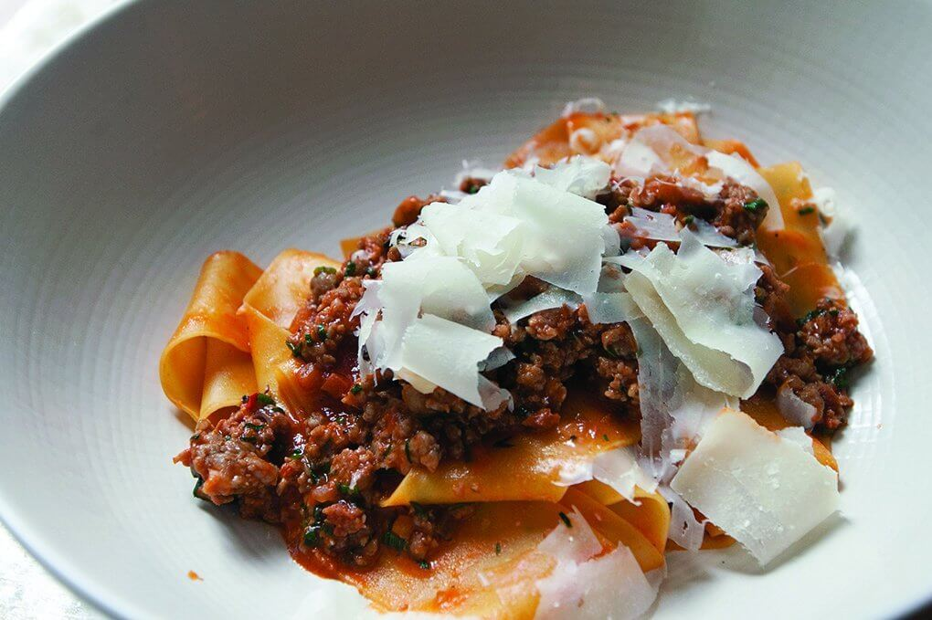 Upland Miami offers a range of comfort pasta dishes including a housemade pappardelle ragù with spicy sausage and Parmesan.