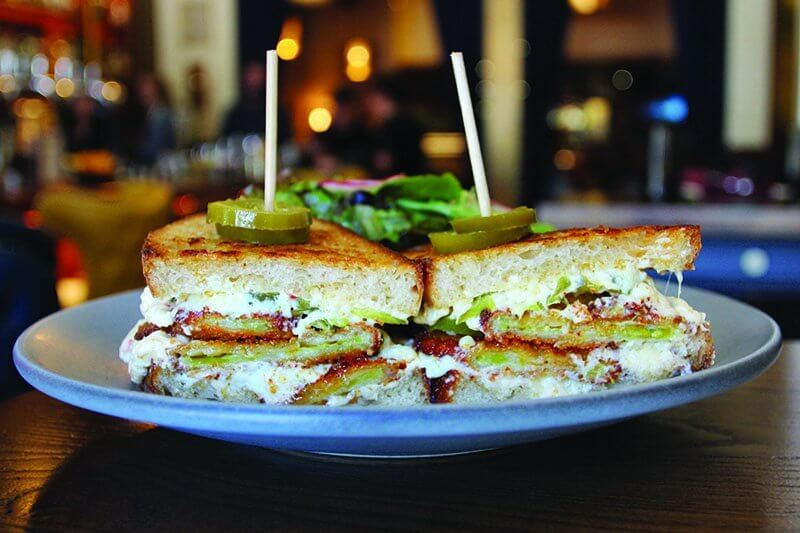 In a nod to both heritage and modern trends, the Southern Grilled Cheese at Finn Town includes fried green tomatoes, pickled jalapeño and housemade pimento cheese.