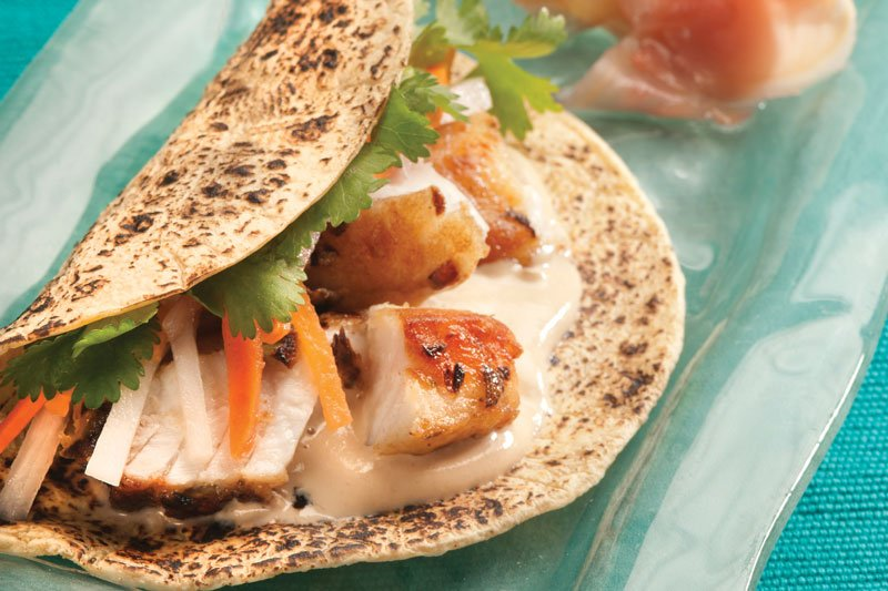 At Chicago's Kendall College, Christopher Koetke demonstrates how fish tacos can tap into global flavors with these barramundi tacos topped with pickled daikon radish, carrot and sesame-soy yogurt sauce
