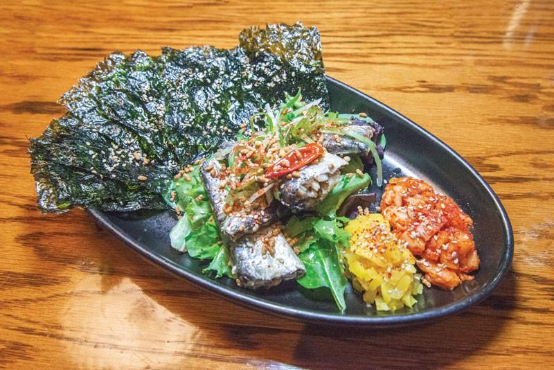 Sardines Conserva at Perilla features mixed greens, toasted nori sheets, toasted rice, kimchi and yellow daikon.