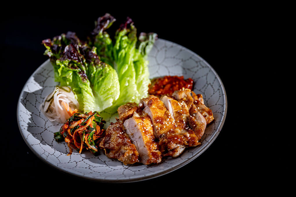 Abang Yoli, a Southeast and East Asian kitchen in Minneapolis' Malcolm Yards, is one of nine vendors strategically chosen to deliver familiarity and intrigue, such as this Chicken Ssam with spicy gochujang.