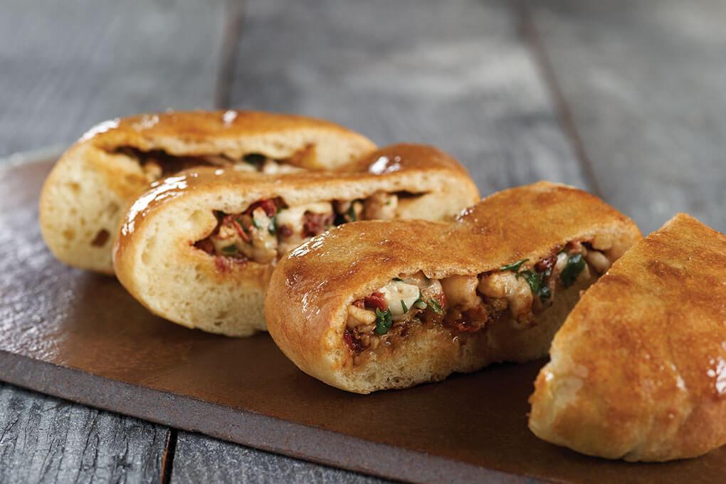 Kiran Verma, chef/owner of Kiran's in Houston, fills and bakes naan dough for her Indian-Mediterranean Caprese Stuffed Naan.