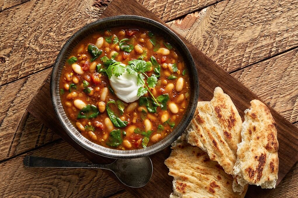 Chef Jeffrey Quasha toasts coriander, mustard seeds, and cumin seeds in oil then layers with fresh ginger, garlic and Bush's Baked Beans in this creative mashup.