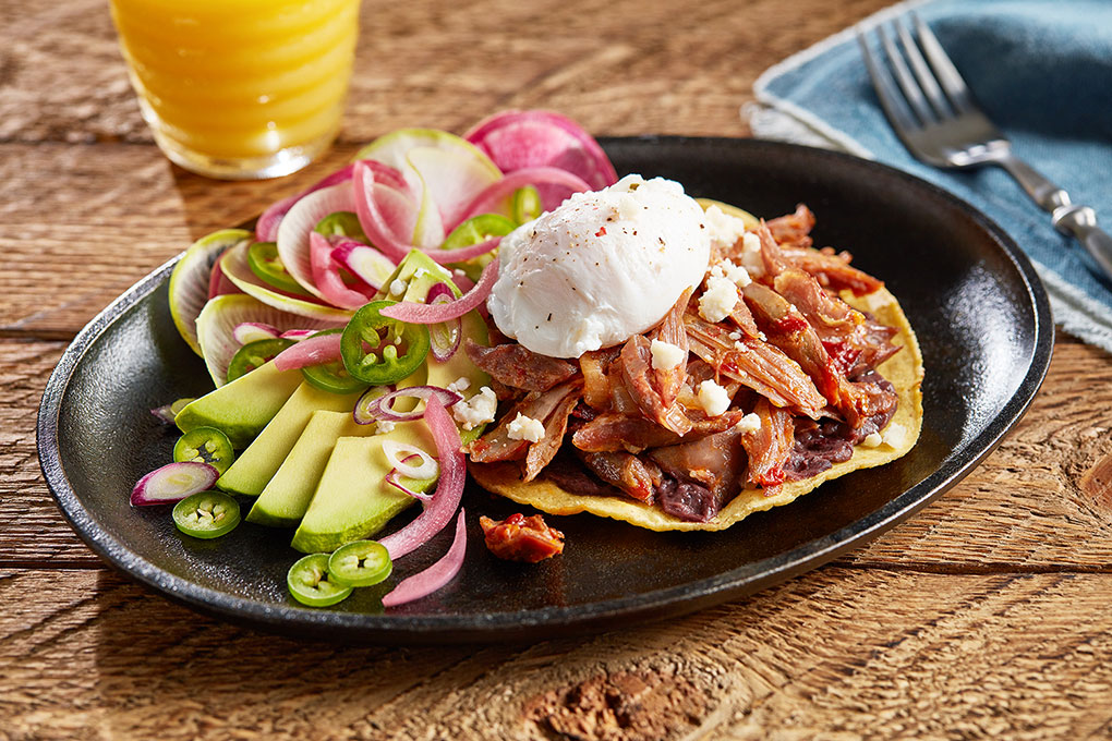 Earthy and smoky lamb tinga, topped with pickled red onions, queso fresco, Mexican crema and a perfectly poached egg.