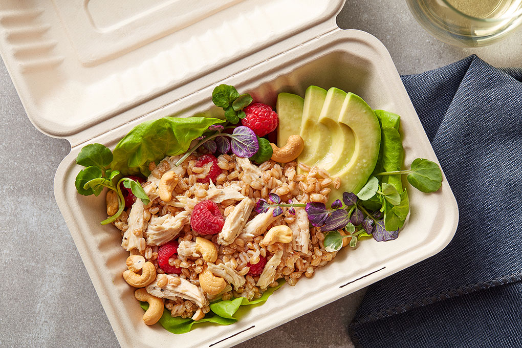 Chef Jennifer Etzkin O'Brien creates a craveable and energizing salad from farro, warm roasted chicken, bright raspberries and crunchy cashews.