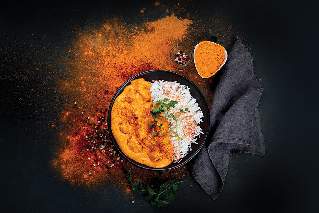 Thanks in large part to the warm, heady notes that are the hallmark of the spice blend garam masala, India's classic butter chicken, as seen here, is moving into the mainstream, showing up in familiar menu items like tacos, loaded fries, and chicken and waffles.