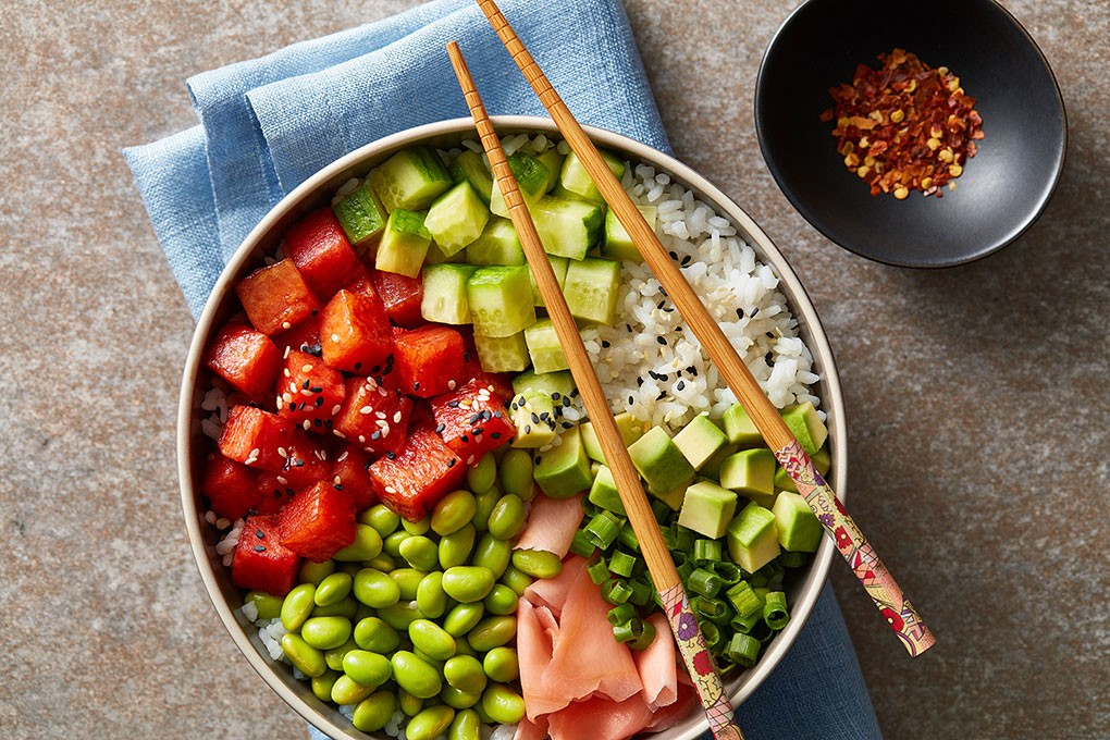 Enjoy this vegan version of a Hawaiian staple with edamame, cucumber, avocado, pickled ginger, scallion, sesame, and sticky rice.